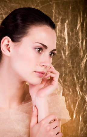 Beautiful young woman on golden background Stock Photo - 13988902