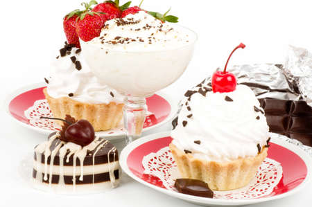 Dessert - sweet cakes with strawberry  on a plate on background photo