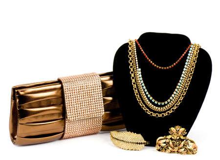 Fashionable handbag and golden jewelry on white background  Archivio Fotografico