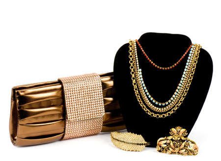 Fashionable handbag and golden jewelry on white background  Banque d'images