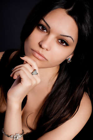 Portrait of beautiful young woman with golden jewelry photo