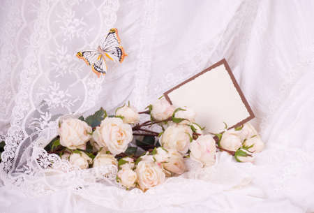 Beautiful bridal flowers with banner add and wedding rings photo
