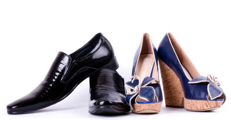 Sexy fashionable man s and womanish shoes on white background