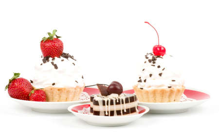 Dessert - sweet cake with strawberry and cherry on a plate on background photo