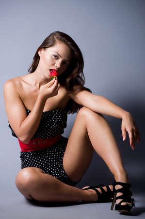 Beautiful sexy woman with strawberry photo