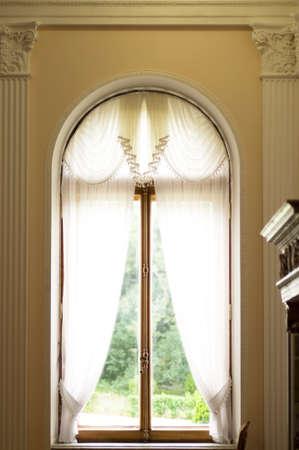 Vintage sun window with curtain 스톡 콘텐츠