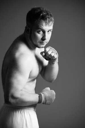 Portrait of boxer on dark background photo