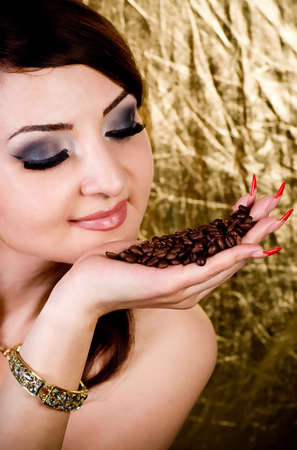Beautiful young woman with coffee photo