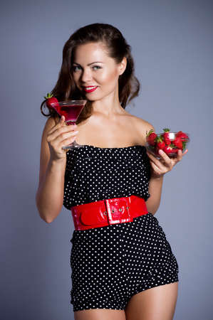 Beautiful sexy woman with strawberry cocktail photo
