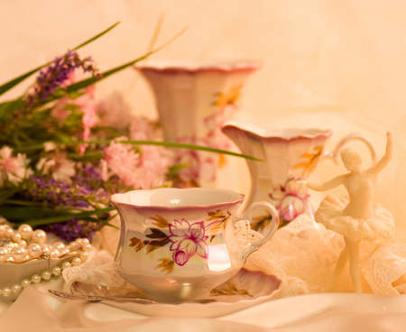 Vintage tea in elegant cups and flowers photo