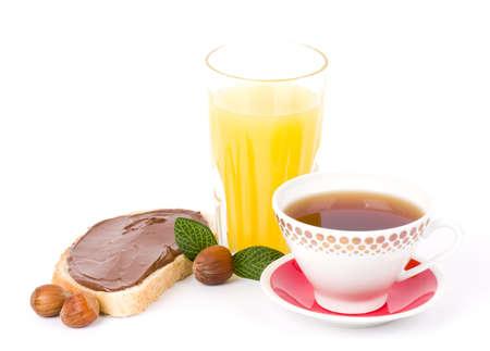Tasty bread with chocolate, tea and orange juice photo