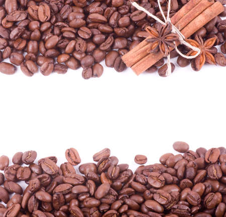 Coffee beans and cinnamon on a white background photo
