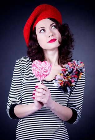 frenchwoman: Beautiful young Frenchwoman with pink spiral lollipops