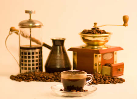 Coffee accessories and little coffee cup on the background photo