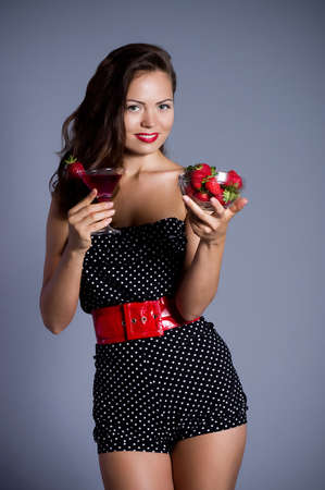 Beautiful sexy woman with strawberry and cocktail