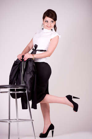 Young Businesswoman with chair on a background photo