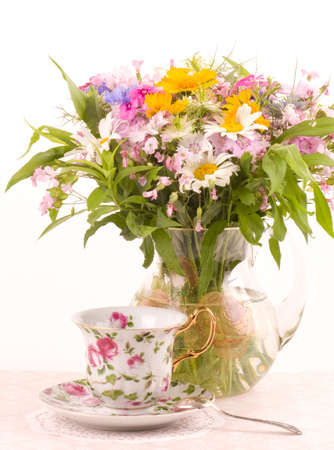 Vintage teacup with beautiful flowers in bowl photo