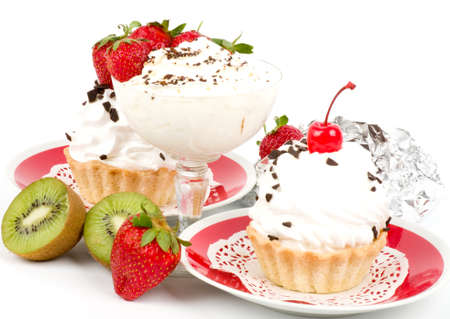 Dessert - sweet cakes with strawberry and cherry on a plate on background photo