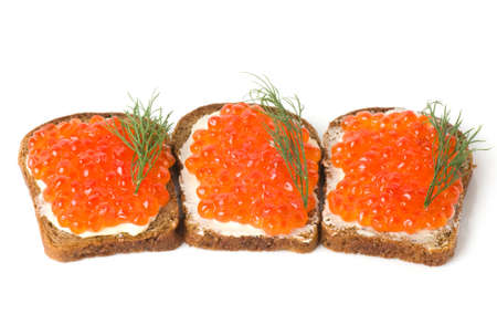 Red caviar with bread and butter on the white background Stock Photo - 14494789