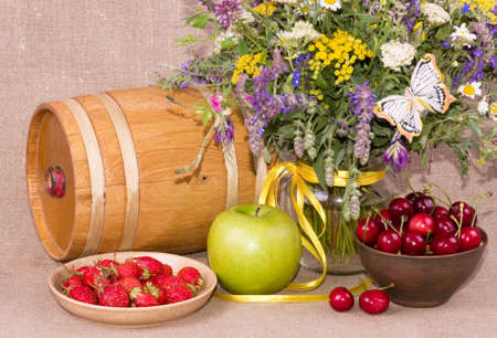 Flowers, barrel, apple, strawberry and cherry photo