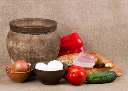 Clay pot, vegetables, oil and meat pork photo