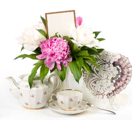 natural setting: Vintage elegant cups with flowers