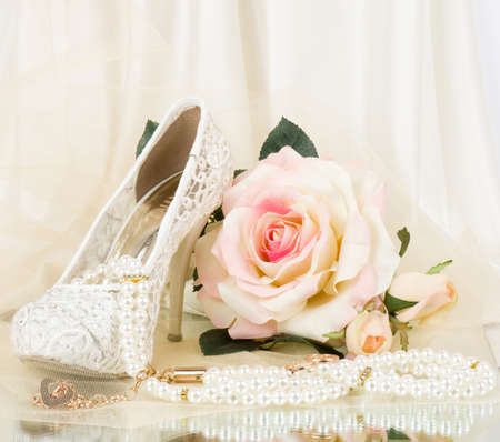 wedding accessories: bridal shoes, pink rose and vintage beads