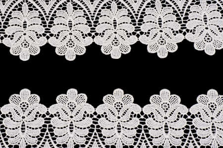 Vintage lace with flowers on black background photo
