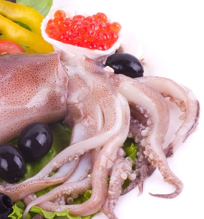 pinkie: Raw squid with vegetables and red caviar on the white background Stock Photo