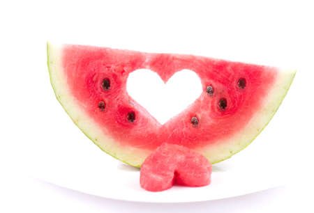 Watermelon with heart isolated on white background photo