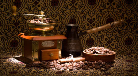 Vintage coffee grinder and metal turk with coffee beans photo