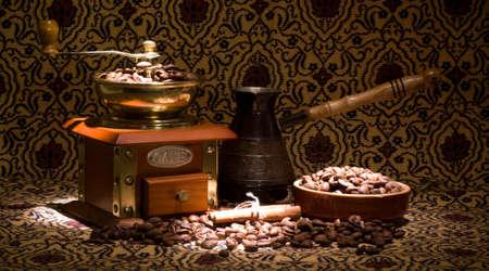 Vintage coffee grinder and metal turk with coffee beans photo