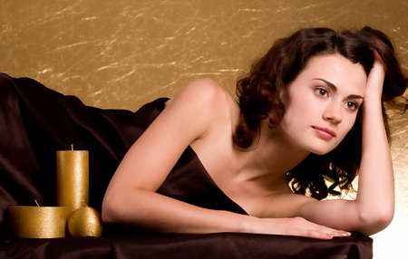 Beauty spa woman with golden candles photo