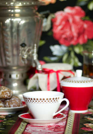 Samovar, a traditional old Russian tea kettle with teacup photo