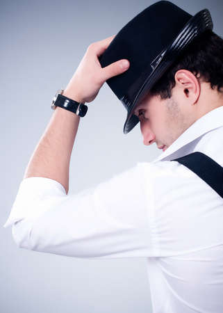 cool boy: Fashionable man with hat on gray background Stock Photo