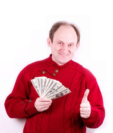 elderly man holding money on white background photo