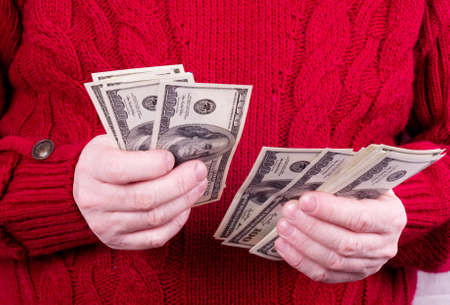 American money in old working man hands photo