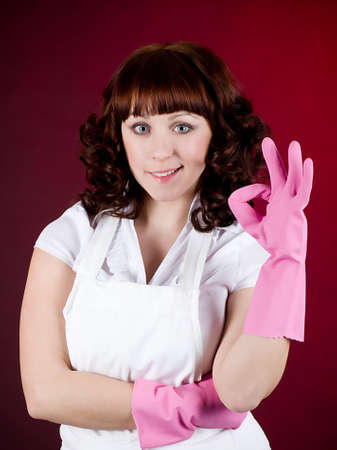 Young happy housewife cleaning dishes photo