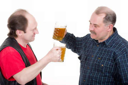 Elderly men holding a beer belly and sausage photo
