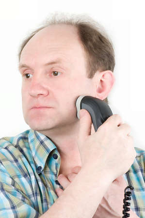 Senior man with electric razor photo