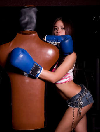 nipples: Sexy brunette woman in boxing gloves