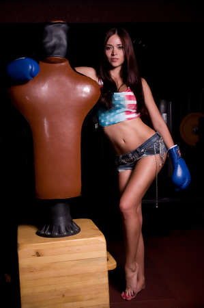 Sexy brunette woman in boxing gloves photo