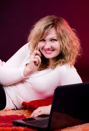 Young beautiful businesswoman with laptop photo
