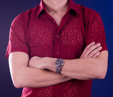 Beautiful man with watch on a blue background Stock Photo - 14925835