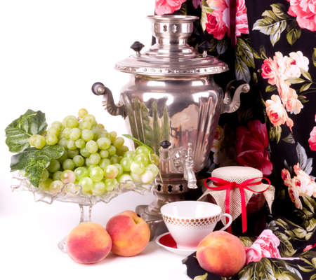 Samovar, a traditional old Russian tea kettle with fruits photo