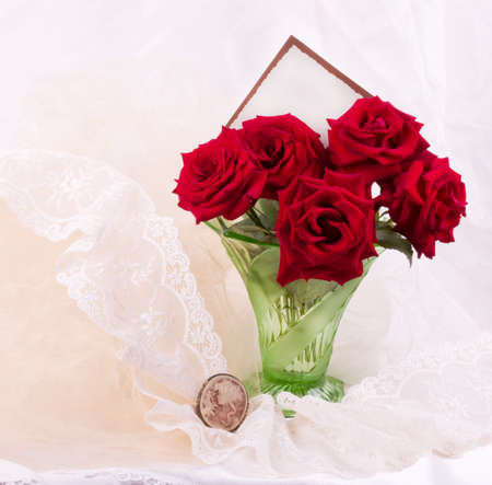 Beautiful red roses in vase with banner add photo