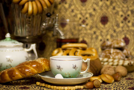 Samovar, a traditional old Russian tea kettle with bagels photo