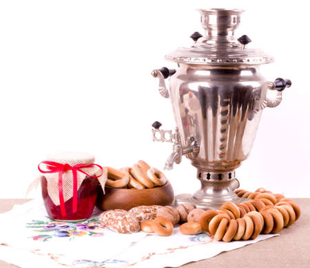 Samovar, a traditional old Russian tea kettle with bagels and jam photo