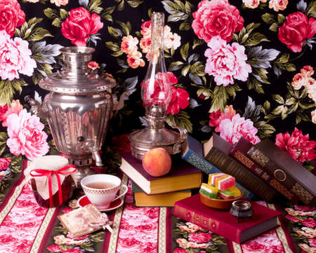 Vintage books and Samovar with cup and books photo