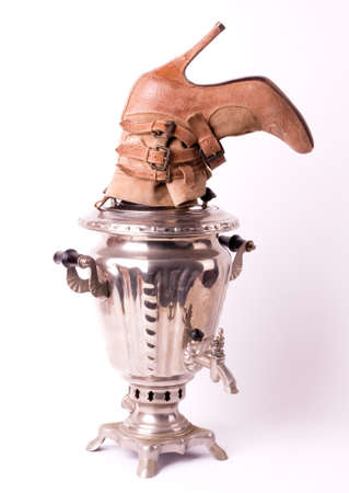 Samovar with shoe on white background photo